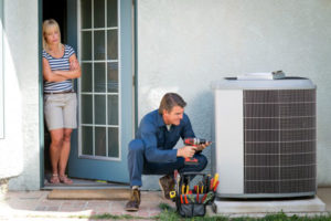 Air conditioning repair being performed by a technician in Alexander City, AL